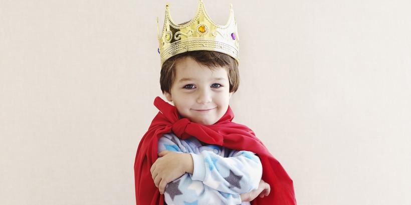 Boy Playing King